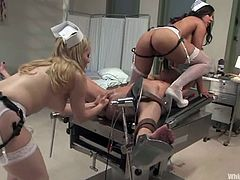 Two amazing girls in nurse uniform tie the blonde girl up and finger her pussy rough. After that this blonde also gets toyed in a hospital.