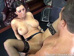 Full bodied brunette cougar Dylan Ryder is wearing black nylon stockings fucking in steamy office sex scene by Naughty America. She gets her profusely wet pussy eaten dry by young thirsty stud. Then he penetrates her cunt in a missionary position.