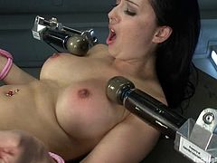 Sexy brunette babe lies on the floor with her legs wide opened. She gets her asshole and pussy stuffed by the fucking machine in close-up scenes.