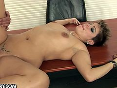 Curvy short haired chic lies on the table right in the office while her voracious boss pokes her missionary style. Later she goes down on her knees to mouth fuck his slim penis.