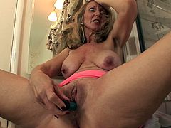 A mature woman performs a hot solo scene where she gets naked and sticks a hard toy in her wet pussy, check it out right here!