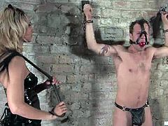 Naughty blonde mistress in classic latex outfit ties the guy up and whips his ass. Later on she rides his huge dick and fixes clothespins to his body.