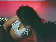 Teeny Indian brunette poses on the bunk bed and shows her big butt