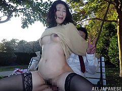 Two men are going to make this Japanese milf feel fucked up! She blows their cocks and then they sweat in her wet pussy outdoors!