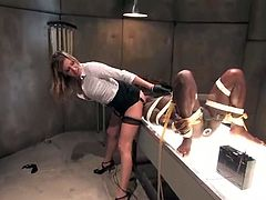 Three dominant sluts are going to humiliate and strapon fuck this black guy in this femdom session packed with bondage and torturing action.