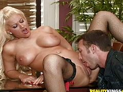 Superb blonde in sexy lingerie and fishnet stockings poses for the camera sitting on a table. After that she gives blowjob & titjob combo before getting fucked in her shaved pussy.