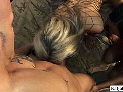 This horny bald headed dude is happy for this ones to have three sexy bitches wearing body fishnet for pleasure. They fondle each other and suck his hard dick in turn.