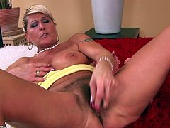 A mature woman gets naked and inserts a hard toy in her fucking pussy right here in this hot solo scene, check it out, yo!