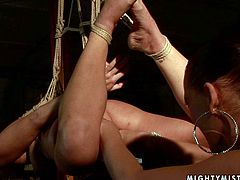 Naive red-haired amateur gets bandaged and suspended in the air before an insatiable domina starts fisting her soaking fresh cunt in BDSM-involved sex video by 21 Sextury.