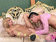 Extremely perverted mature slut knows how to dress up this guy like a girl. She gives him one hell of a blowjob in exchange for cunnilingus.