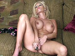 A dirty-ass blonde fucking bitch gets naked for the camera and fucking sticks a hard toy in her pink-ass fucking pussy! Check it out!