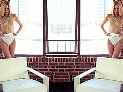 Slender blonde girl takes her clothes off in solo video. She shows her small tits and shaved pussy in the loft.