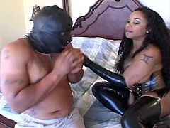 This sensual ebony mistress clad in latex gloves and boots takes her time to suck her slave's white cock. Then she's ready to get even more perverse as she rides it with her ass.