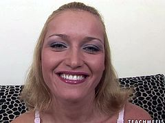 Playful chick Kathia strips and exposes her pinkish pussy