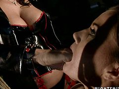 Salty brunette whore gets suspended by a sophisticated domina, who forces her suck her claw before she finger fucks her bald soaking twat in BDSM sex video by 21 Sextury.