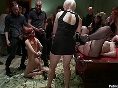 Lewd redhead milf Tina Horn loves to be punished. She lets some guys tie her up and enjoys getting tortured by everybody who is there.