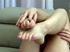 Sweetie amazes with her soft feet while posing them during hot solo