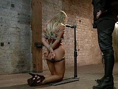 Slutty blonde Cameron Dee gets bound to a wooden construction in a basement. Then some person pokes a dildo into Cameron's cunt and she moans insanely with pleasure.