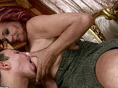 Kinky dude dives in fat and ugly pussy of one mature red haired chick. He spreads her legs wide and polishes her cunt with his playful tongue.