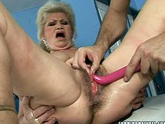 This aged whore with big boobs needs a good dildo machine to get maximum satisfaction. Spoiled granny gets her pussy drilled hard like never before.