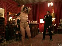 This BDSM scene will drive you crazy! One blindfolded lady is suspended in air in the circle formed of wax candles. Bunch of guys pour hot red wax on her back making her cry hard.