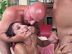 Three perverted guys capture red haired chick for hardcore porn session. While she is sitting down on her knees they piss onto her face and tits.