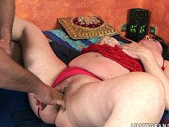 Flamboyant brunette BBW lies wearing red lingerie while a young fucker fingers her puffy slit. Later he pokes it sideways and doggy style in perverse sex clip by 21 Sextury.