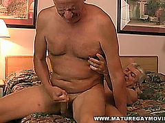 Hot hardcore bareback action between two mature men.