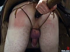 Horny blonde girl bounds a guy in a barn. After that he gets his ass stuffed deep and hard from behind. Later on she also sucks his cock and pinches balls.