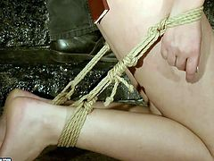 Two dirty bitches are tiding up at master's house. Then brunette mom gets tied up and pushed in her mouth with solid rod. She sucks it deepthroat.