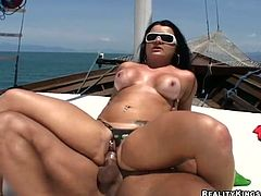 Curvy brunette Amandah Matarazzo is having a good time with some guy on a yacht. She favours the dude with a hot blowjob and then they bang ardently doggy style and in other positions.