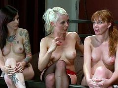 A Redhead and a brunette get dominated by nasty blonde