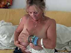 Granny Isabel lets her big tits hang free and masturbates in pantyhose. She spreads her old legs for you and rubs her pussy for an orgasm!
