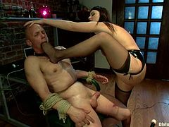 The bald guy will get his ass fucked by Sophie Dee as she uses her strapon dildo in this bondage session after spanking his butt.