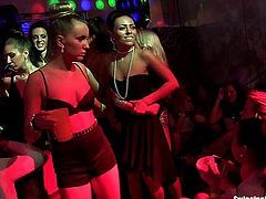 Naughty lesbians dancing lasciviously and fucking giant cocks in a club sex party