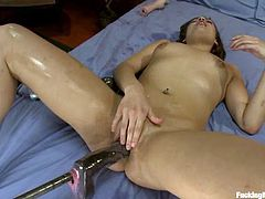 Sexy brown-haired milf Ashlynn Leigh is lying on a bed with her legs moved wide apart and gets her soaking wet coochie slammed by a fucking machine.