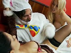 The easter bunny gets his own present by two hot chick, he fucks them hard in their hot pussies and they love to ride him hard on the couch till he cums on their pretty mouth.