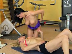 Two sex hungry brunette chics hook up in the gym during intensive training. One of them inclines to tasty mouth of another chic that lies on her back to allow her suck her nipples before she proceeds to stroking her vagina with manicured fingers.