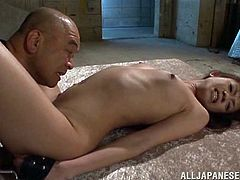 He has a lot of sex toys to use on his slutty slave. The Japanese lady lays on the floor and he gets to work. She is tied down and he eats her pussy and grabs her tits. She has her legs put behind her head and he uses sex toys on her clit and asshole.