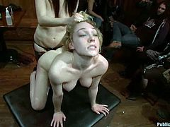 Blonde hottie gets tied up and toyed with a vibrator. Later on she gets fucked in both holes with strap on and dicks.