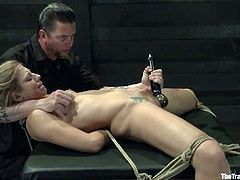 Amazing blonde girl lies on a wooden box being tied up. She gets her vagina toyed with a dildo and a vibrator.
