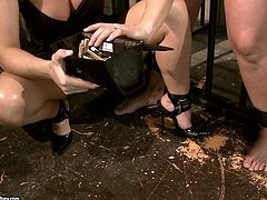 Kinky blond head wears black dress and treats submissive brunette in a rough way. She ties up booty black head with ropes, pins her nipples with metal clothes pegs and rubs her clit passionately.