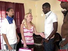 Watch this tight little blonde babe trapped by three horny big black cocks.These black dudes show her no mercy and fucks her in her tight clean pussy and even her little butt hole till they all cum in her sweet mouth