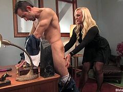 The big boobed Alexis Golden is going to strapon fuck this guy in this femdom session packed with bondage in the office.