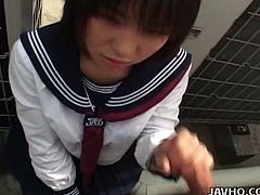 This hot Japanese babe in her school uniform sucks a much older guy's cock.  She then lifts up her short skirt and pulls down her white panties.