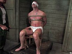 A guy was made prisoner and now the army officer is going to have fun with him, tying him, torturing his cock and banging his ass.