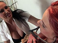 These are two luscious bitches that love rough sex games. Red haired one is hogtied with her legs spread wide apart. Dark head mistress fingers her wet clam.