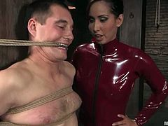 Sexy brunette in latex bodysuit ties the guy up. Then she licks her ass and pussy. Later on she gives him a handjob and toys his ass.