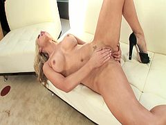 Karden Kross is a busty blonde with big nipples. She strips and teases with her perfect body. Then, she touches herself intimately and fucks her wet hole with a vibrator.
