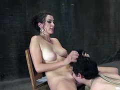 Princess Donna Dolore puts hot slut Selina into irons in a basement. The mistress tortures the girl and then smashes her vag with a toy and beats her butt with a stick.